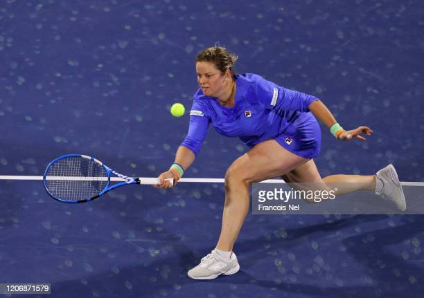 Kim Clijster of Belguim in action against Garbine Muguruza of Spain during her Women's Singles match on Day One of the Dubai Duty Free Tennis...