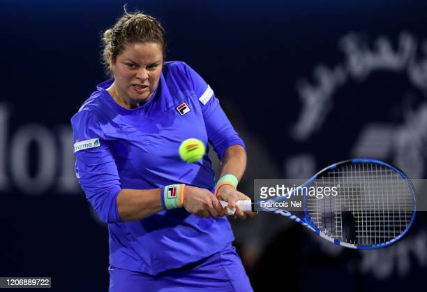 Kim Clijster of Belguim plays a backhand against Garbine Muguruza of Spain during her Women's Singles match on Day One of the Dubai Duty Free Tennis...
