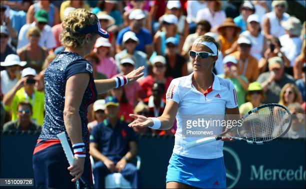 Kim Clijsters and Kirsten Flipkens of Belgium celebrate during their match against ChiaJung Chuang and Shuai Zhang during Day Four of the 2012 US...