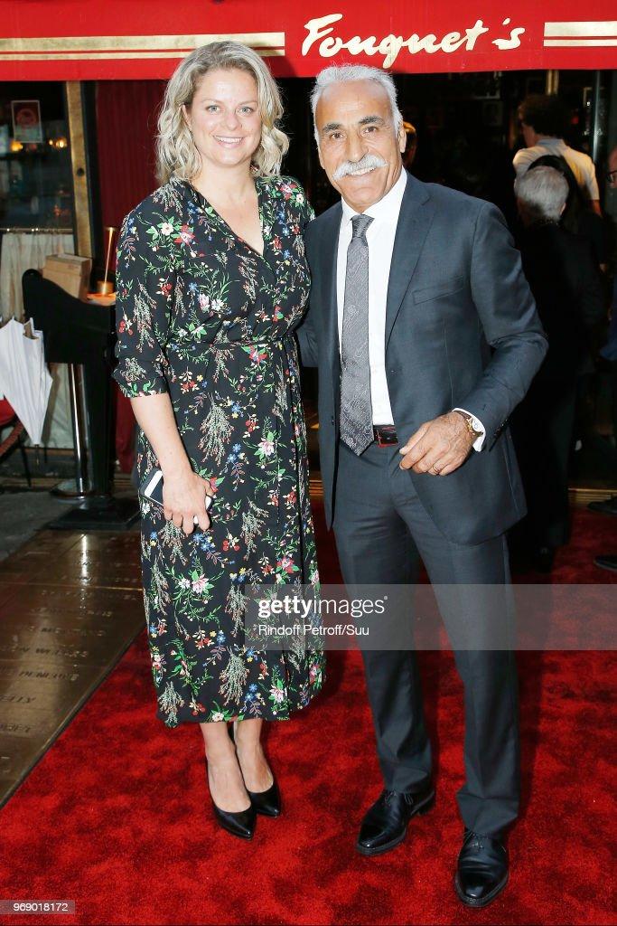 Kim Clijsters and Mansour Bahrami attend 'Diner des Legendes' at Le Fouquet's on June 6, 2018 in Paris, France.
