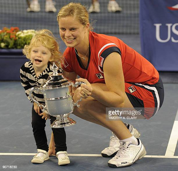 Kim Clijsters from Belgium and her daughter Jada with her trophy after defeating Caroline Wozniacki from Denmark to win the Women's Final US Open...