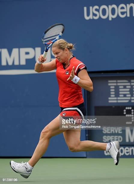 Kim Clijsters hits a ball back to Na Li during day nine of the 2009 US Open at the USTA Billie Jean King National Tennis Center on September 8 2009...