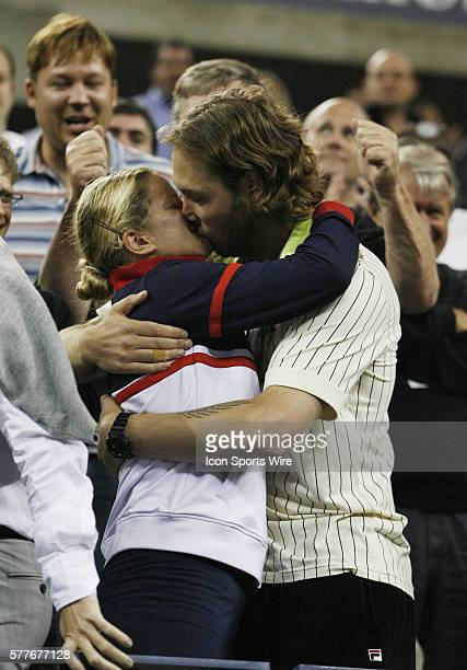 Kim Clijsters hugs and kisses her husband after her match in the Womens Finals in her 2009 US Open match against Caroline Wozniacki in Arthur Ashe...