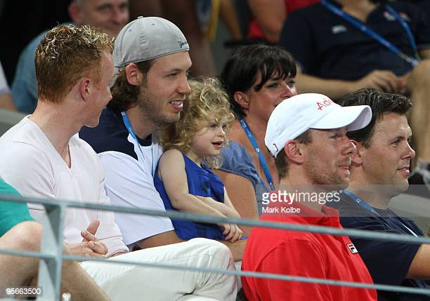 Kim Clijsters husband Brian Lynch and daughter Jada of Belgium watch the presentation ceremony after the Women's final against Justine Henin of...