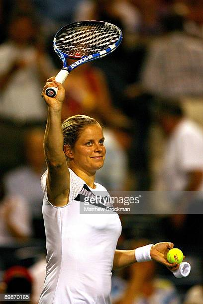 Kim Clijsters of Belgium acknowledges the crowd after defeating Elena Baltacha of Great Britain during the Rogers Cup at the Rexall Center on August...