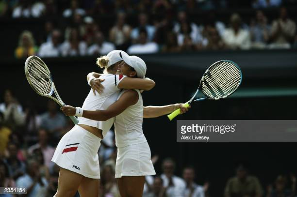 Kim Clijsters of Belgium and Ai Sugiyama of Japan celebrate after their victory over Virginia Ruano Pascual of Spain and Paola Suarez of Argentina in...
