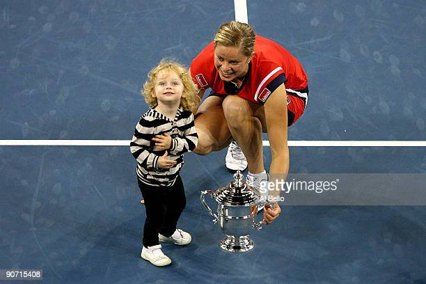 Kim Clijsters of Belgium and daughter Jada pose with the championship trophy after Clijsters defeated Caroline Wozniacki of Denmark in the Women�s...
