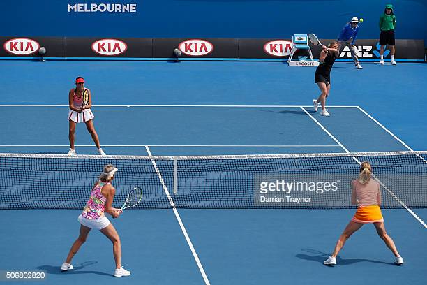 Kim Clijsters of Belgium and Iva Majoli of Croatia comepete in their match against Nicole Bradkte of Australia and Barbara Schett of Austria during...