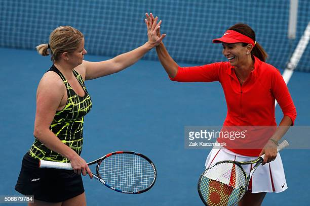 Kim Clijsters of Belgium and Iva Majoli of Croatia compete in their match against Lindsay Davenport of the United States and Martina Navratilova of...