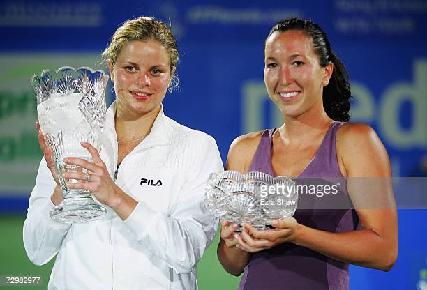 Kim Clijsters of Belgium and Jelena Jankovic hold their trophies after Clijsters came from behind to beat Jankovic 46 76 64 in the women's singles...