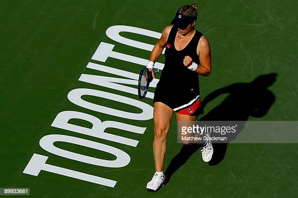Kim Clijsters of Belgium celebrates a point against to Victoria Azarenka of Belarus during the Rogers Cup at the Rexall Center on August 19 in...
