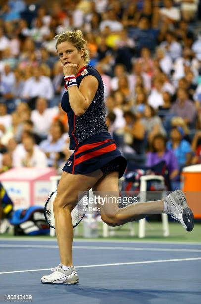 Kim Clijsters of Belgium celebrates after defeating Victoria Duval of the United States in their women's singles first round match against on Day One...