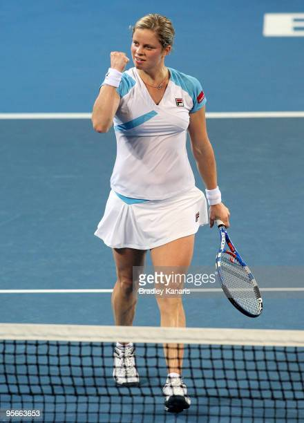 Kim Clijsters of Belgium celebrates victory after winning the Womens final match against Justine Henin of Belgium during day seven of the Brisbane...