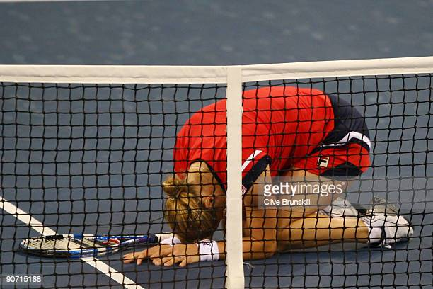 Kim Clijsters of Belgium celebrates winning championship point against Caroline Wozniacki of Denmark in the Women�s Singles final on day fourteen of...