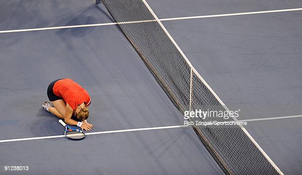 Kim Clijsters of Belgium falls to her knees after defeating Caroline Wozniacki of Denmark in the Women's Singles final on day fourteen of the 2009 US...