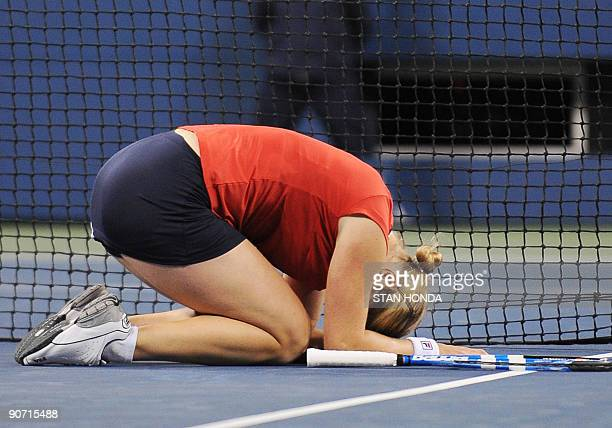 Kim Clijsters of Belgium falls to her knees as she celebrates her 75 63 win over Caroline Wozniacki of Denmark during the Women's Finall match at the...