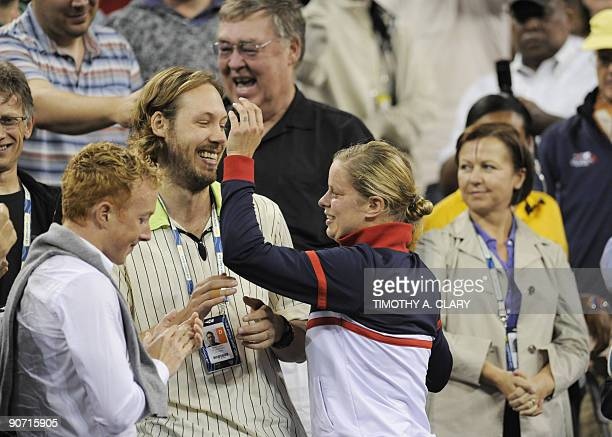 Kim Clijsters of Belgium her husband Brian Lynch with friends and family celebrates her 75 63 win over Caroline Wozniacki of Denmark during the...