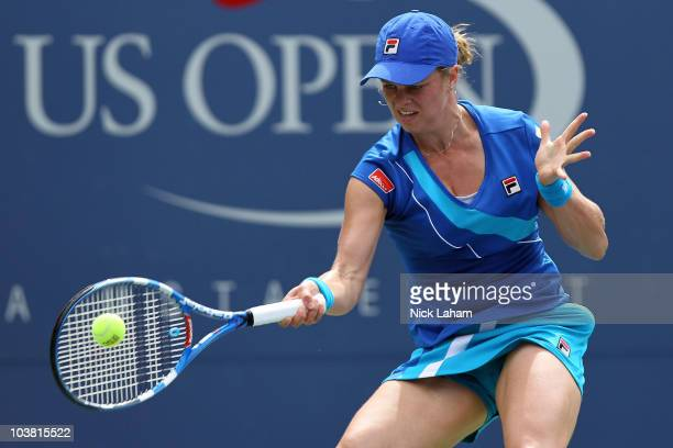 Kim Clijsters of Belgium hits a forehand return against Petra Kvitova of the Czech Republic of during her women's singles match on day five of the...