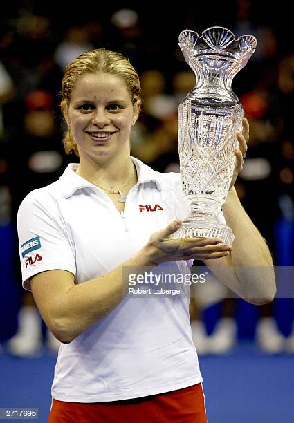 Kim Clijsters of Belgium holds her trophy after defeating Amelie Mauresmo of France 62 60 in the final match of the Bank of America WTA Tour...