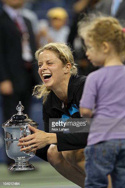 Kim Clijsters of Belgium holds the championship trophy as she celebrates with her daughter Jada after Clijsters defeated Vera Zvonareva of Russia...