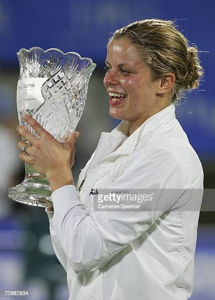 Kim Clijsters of Belgium holds the trophy aloft after winning the women's singles final 46 76 64 against Jelena Jankovic of Serbia on day six of the...