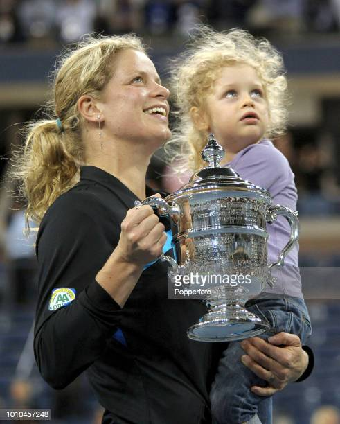 Kim Clijsters of Belgium holds the trophy and her daughter Jada after her victory over Vera Zvonareva of Russia following the Ladies' singles final...