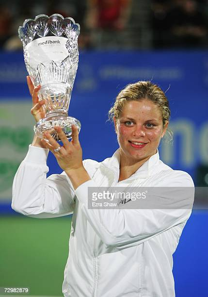 Kim Clijsters of Belgium holds up the trophy after beating Jelena Jankovic of Serbia 46 76 64 in the women's singles final on day six of the 2007...