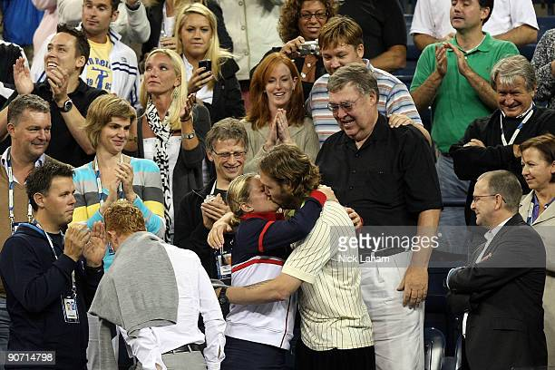 Kim Clijsters of Belgium meets her family after winning championship point against Caroline Wozniacki of Denmark during the Women�s Singles final on...