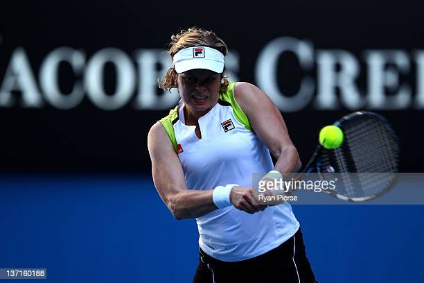 Kim Clijsters of Belgium plays a backhand during her round one match against Maria Joao Koehler of Portuga during day one of the 2012 Australian Open...