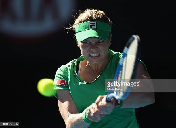 Kim Clijsters of Belgium plays a backhand in her semifinal match against Vera Zvonareva of Russia during day eleven of the 2011 Australian Open at...