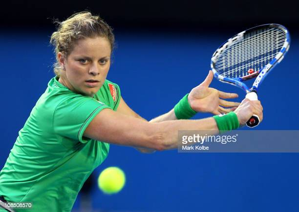 Kim Clijsters of Belgium plays a backhand in her women's final match against Na Li of China during day thirteen of the 2011 Australian Open at...