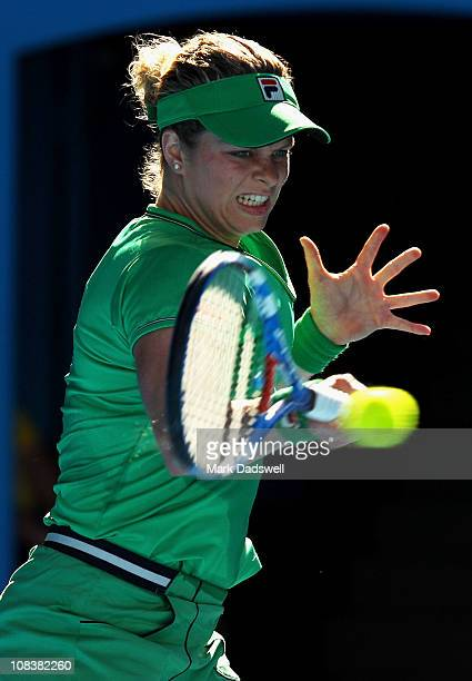 Kim Clijsters of Belgium plays a forehand in her semifinal match against Vera Zvonareva of Russia during day eleven of the 2011 Australian Open at...