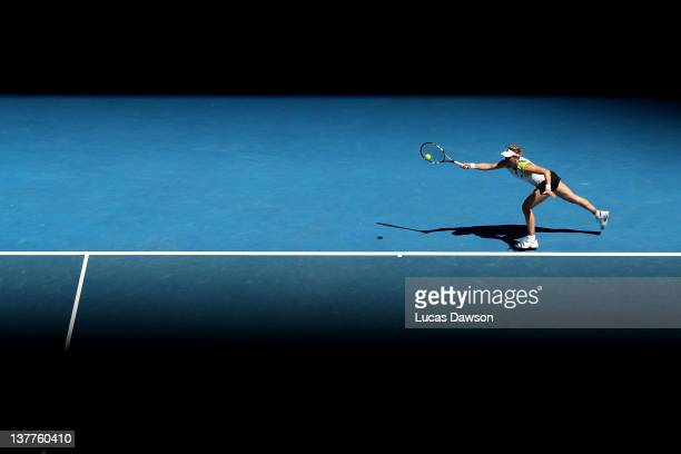 Kim Clijsters of Belgium plays a forehand in her semifinal match against Victoria Azarenka of Belarus during day eleven of the 2012 Australian Open...