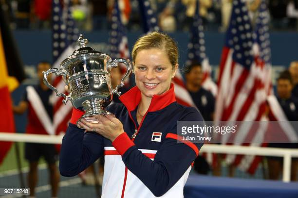 Kim Clijsters of Belgium poses with the championship trophy after defeating Caroline Wozniacki of Denmark in the Women�s Singles final on day...