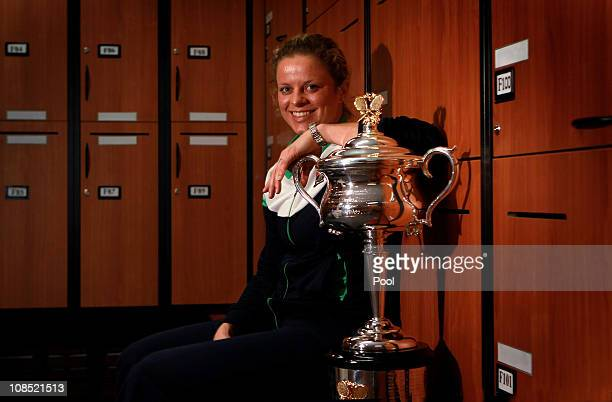 Kim Clijsters of Belgium poses with the Daphne Akhurst Trophy in the changing room after winning her women's final match against Na Li of China...
