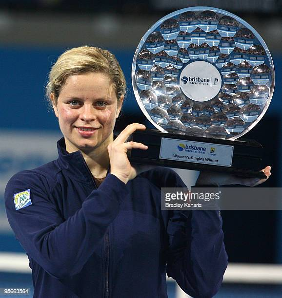Kim Clijsters of Belgium poses with the trophy after winning the Womens final match against Justine Henin of Belgium during day seven of the Brisbane...