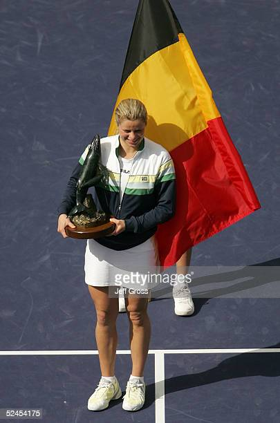 Kim Clijsters of Belgium poses with the trophy and the Belgium flag after winning the championship final of the Pacific Life Open over Lindsay...