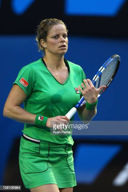 Kim Clijsters of Belgium reacts after winning her first round match against Dinara Safina of Russia during day two of the 2011 Australian Open at...