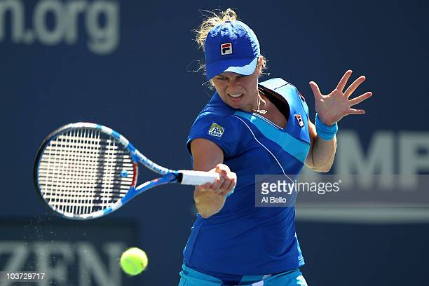 Kim Clijsters of Belgium returns a forehand against Greta Arn of Hungary during the Women's Singles first round match on day one of the 2010 US Open...