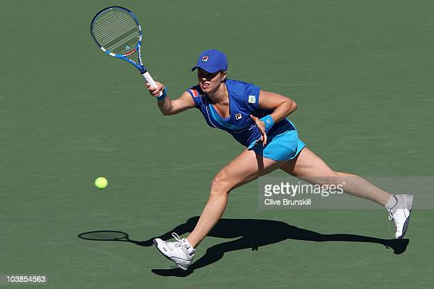 Kim Clijsters of Belgium returns a shot against Ana Ivanovic of Serbia during her women's singles match on day seven of the 2010 US Open at the USTA...