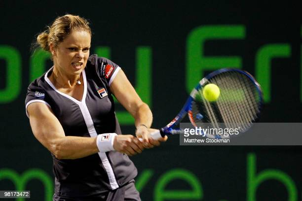 Kim Clijsters of Belgium returns a shot against Samantha Stosur of Australia during day nine of the 2010 Sony Ericsson Open at Crandon Park Tennis...