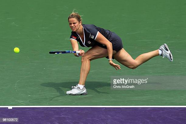 Kim Clijsters of Belgium returns a shot against Shahar Peer of Israel during day six of the 2010 Sony Ericsson Open at Crandon Park Tennis Center on...