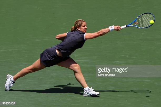 Kim Clijsters of Belgium returns a shot against Venus Williams of the United States during the women's final of the 2010 Sony Ericsson Open at...