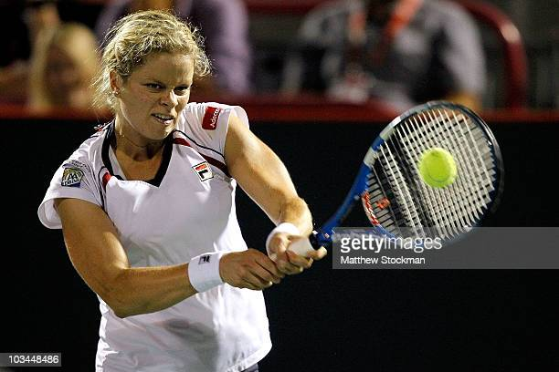 Kim Clijsters of Belgium returns a shot to Bethanie Mattek-Sands of the United States during the Rogers Cup at Stade Uniprix on August 18, 2010 in...