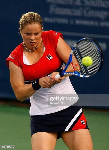 Kim Clijsters of Belgium returns a shot to Marion Bartoli of France during Day 1 of the Western Southern Financial Group Women's Open on August 10...