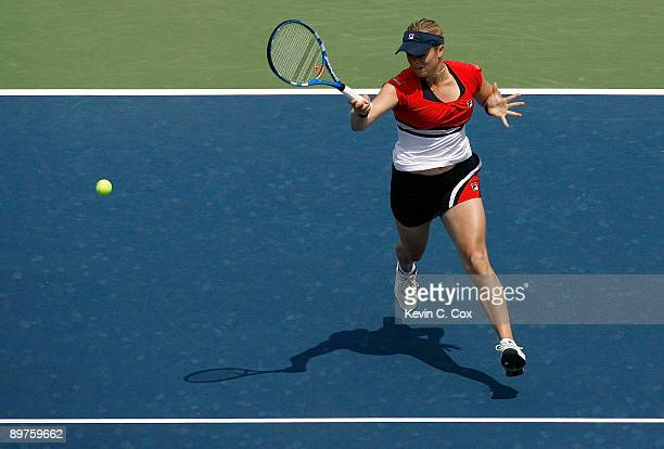 Kim Clijsters of Belgium returns a shot to Patty Schnyder of Switzerland during Day 3 of the Western Southern Financial Group Women's Open on August...