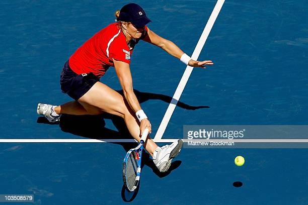 Kim Clijsters of Belgium returns a shot to Vera Zvonareva of Russia during the Rogers Cup at Stade Uniprix on August 20 2010 in Montreal Canada