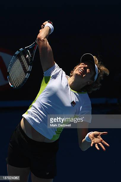 Kim Clijsters of Belgium serves during practice ahead of the 2012 Australian Open at Rod Laver Arena on January 15 2012 in Melbourne Australia