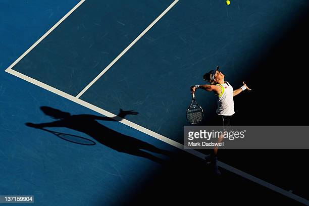 Kim Clijsters of Belgium serves in her first round match against Maria Joao Koehler of Portugal during day one of the 2012 Australian Open at...