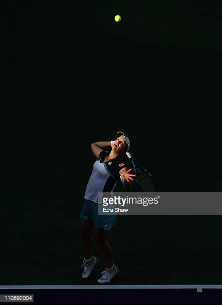 Kim Clijsters of Belgium serves to Alla Kudryavtseva of Russia during the BNP Paribas Open at the Indian Wells Tennis Garden on March 11 2011 in...